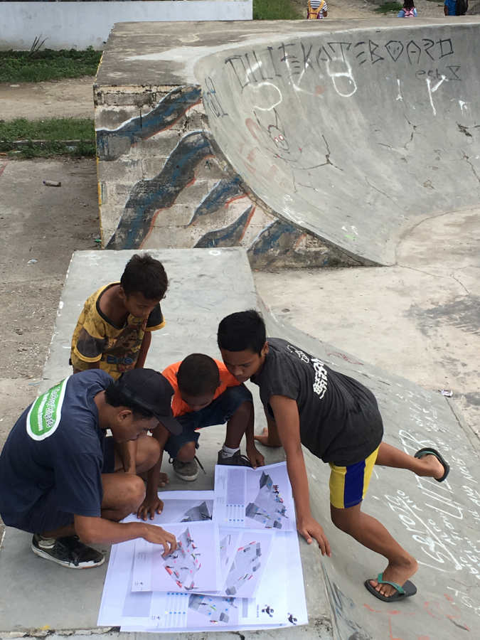 Dili local skaters checking out the park design.